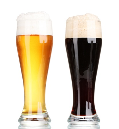 brown bottle: black and golden beer in glasses isolated on white