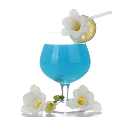 glass of blue cocktail with lime and flowers isolated on white photo