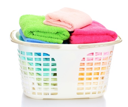 Plastic basket with bright towels isolated on white Stock Photo - 13517727