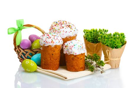 Beautiful Easter cakes, colorful eggs in basket and pussy-willow twigs isolated on white photo