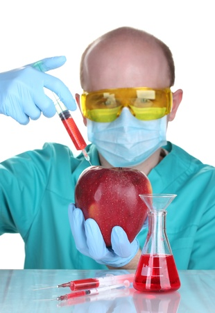 Scientist injecting GMO into the apple