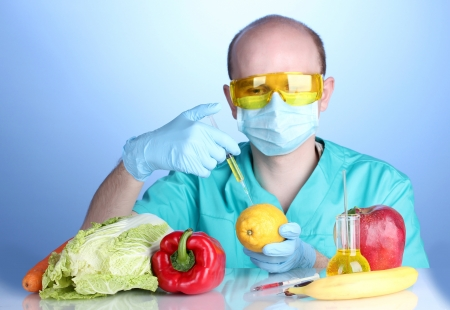 genetically: Scientist injecting GMO into the lemon