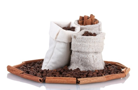 Coffee beans and cinnamon in canvas sacks isolated on white Stock Photo - 13517785