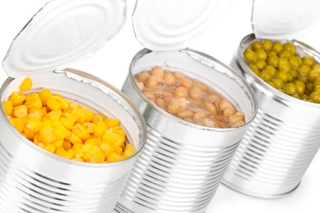 hermetic: Open tin cans of corn, beans and peas isolated on white Stock Photo