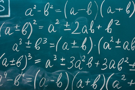maths: Math formulas written on the desk