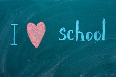 I love school - written in colorful chalk on the blackboard Stock Photo - 13514707