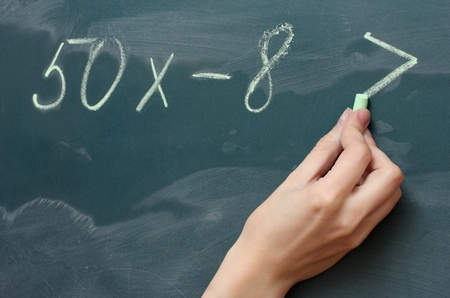 Hand writing mathematical test on the blackboard Stock Photo - 13514698