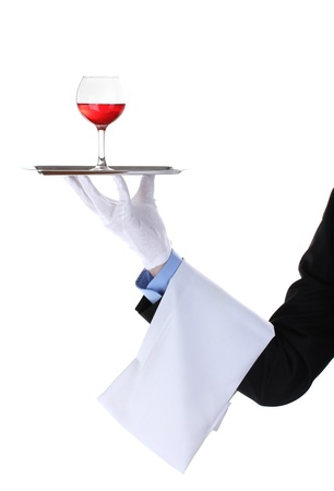 catering service: formal waiter with a glass of wine on silver tray isolated on white