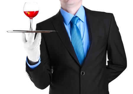 formal waiter with a glass of wine on silver tray isolated on white photo