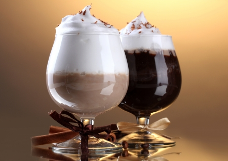 glasses of coffee cocktail on brown background photo