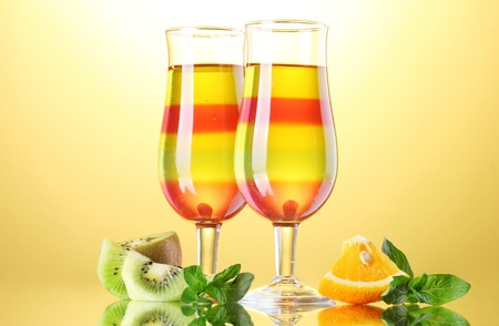 fruit jelly in glasses and fruits on yellow background Stock Photo - 13517731