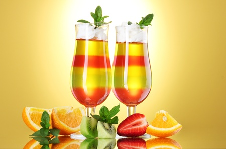 fruit jelly in glasses and fruits on yellow background Stock Photo - 13517128