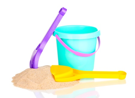 Children's beach toys and sand isolated on white photo