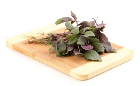 Fresh basil on wooden board isolated on white Stock Photo - 13580488
