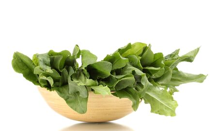 Fresh sorrel in wooden bowl isolated on white Stock Photo - 13581421