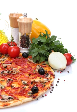 delicious pizza and vegetables isolated on white  Stock Photo - 13580317