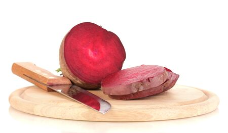 Young red beet and knife on wooden board isolated on white photo