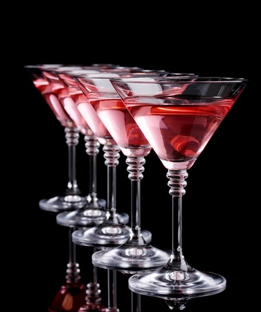 vodka: Red cocktail in martini glasses isolated on black Stock Photo