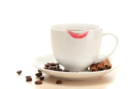 cup of coffee with lipstick mark beans and cinnamon sticks isolated on white Stock Photo - 13581627