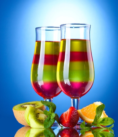 fruit jelly in glasses and fruits on blue background Stock Photo - 13580239
