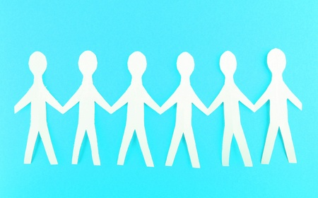 Paper people on blue background photo