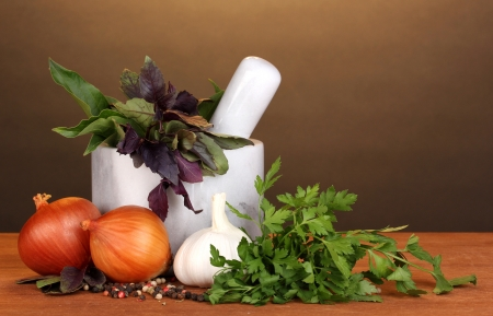 Set of ingredients and spice for cooking on wooden table on brown background photo