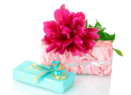 beautirul pink gifts and peony flower isolated on white photo