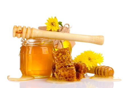 two jars of honey, honeycombs and wooden drizzler isolated on white photo
