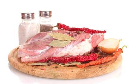 Raw meat and vegetables on a wooden board isolated on whitе Stock Photo - 13665772