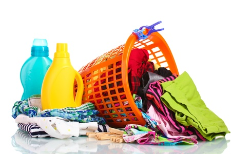 dirty clothes: Clothes with detergent and in green plastic basket dropped isolated on white Stock Photo