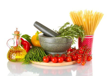 spaghetti in cup, rosemary in mortar, jar of oil and vegetables on wooden board isolated on white photo
