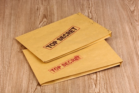 Envelopes with top secret stamp on wooden background Stock Photo - 13667190
