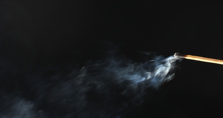 match with abstract smoke on black background Stock Photo - 13664876