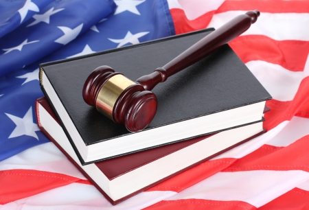 judge gavel and books on american flag background photo