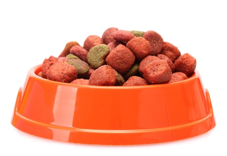 dry food: dry dog food in orange bowl  isolated on white Stock Photo