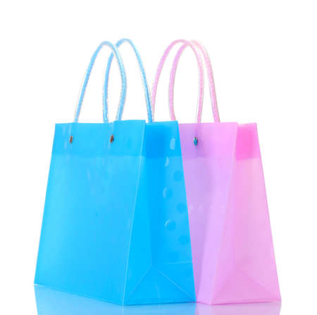 bright pink and blue shopping bags isolated on white photo
