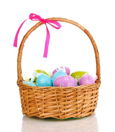 hanging basket: Colorful easter eggs in basket isolated on white Stock Photo