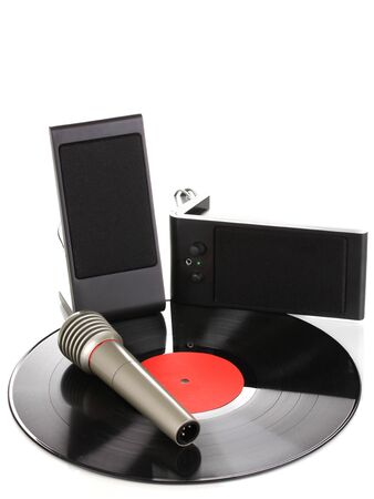 Black vinyl record with loudspeakers and microphone isolated on white photo