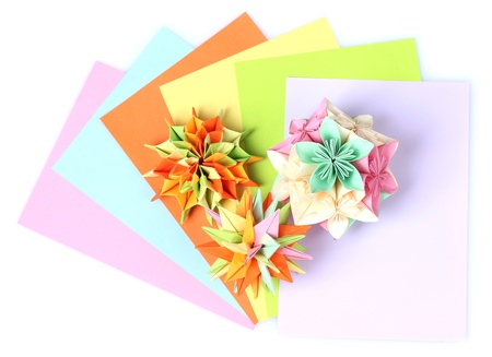 Colorfull origami kusudamas and bright paper isolated on white photo