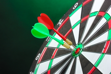 dart board with darts on green background Stock Photo - 13667001