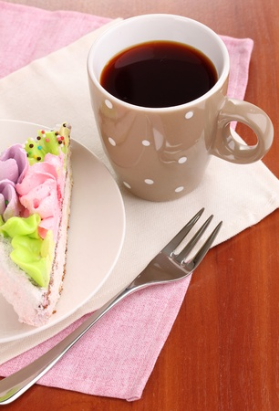 Creamy cake on saucer on table close-up Stock Photo - 13667036