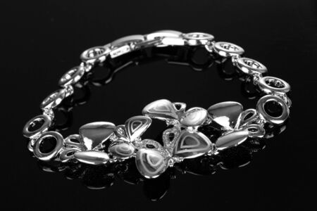 Beautiful silver bracelet with precious stones on black background Stock Photo - 13665731