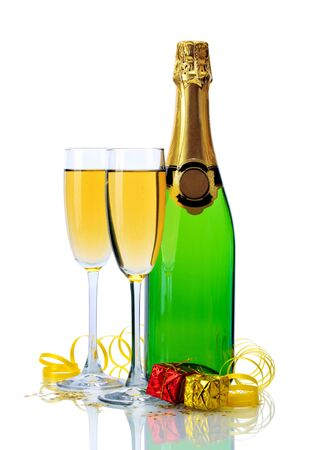 glasses and bottle of champagne, gifts and serpentine isolated on a white Stock Photo - 13665359