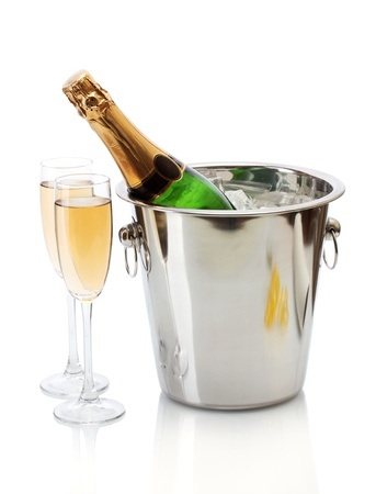 green bottle: Champagne bottle in bucket with ice and glasses of champagne, isolated on white Stock Photo