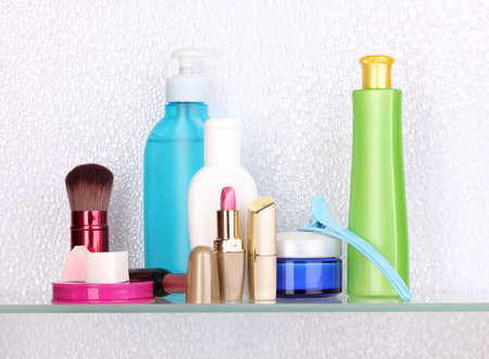 Shelf with cosmetics and toiletries in bathroom Stock Photo - 13666747