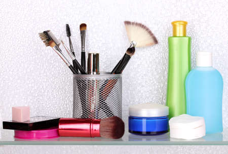 Shelf with cosmetics and toiletries in bathroom Stock Photo - 13666974