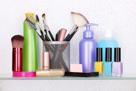 Shelf with cosmetics and toiletries in bathroom Stock Photo - 13666986