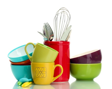 clean kitchen: bright empty bowls, cups and kitchen utensils isolated on white
