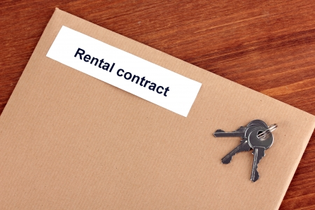 Rental contract on wooden background close-up photo