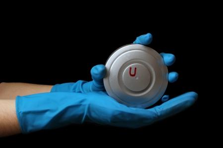 Uranium in hands isolated on black Stock Photo - 13681150